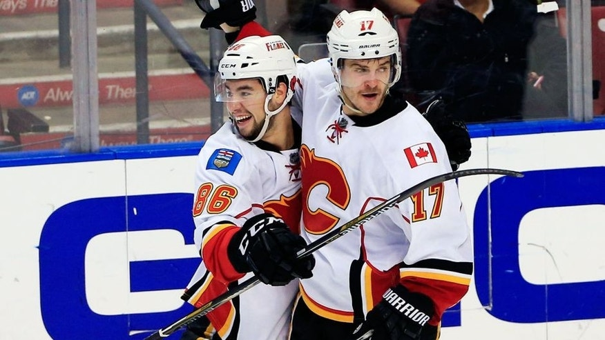 Nov 8, 2014; Sunrise, FL, USA; Calgary Flames left wing Lance Bouma (17) celebrates his goal against the Florida Panthers with center Josh Jooris (86) in the third period at BB&T Center. The Flames won 6-4. Mandatory Credit: Robert Mayer-USA TODAY Sports