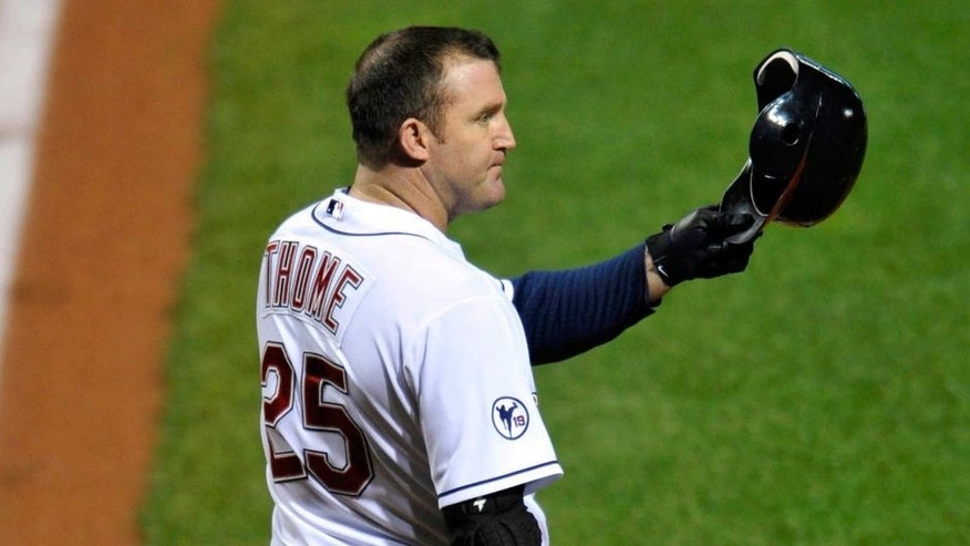 Sep 23, 2011; Cleveland, OH, USA; Cleveland Indians designated hitter Jim Thome (25) raises his batting helmet in the air as fans give him a standing ovation in the first inning against the Minnesota Twins at Progressive Field. Mandatory Credit: David Richard-USA TODAY Sports