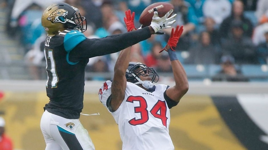 <p>Jacksonville Jaguars wide receiver Marqise Lee, left, makes a reception over Houston Texans cornerback A.J. Bouye (34) for a 50-yard gain during the first half of an NFL football game in Jacksonville, Fla., Sunday, Dec. 7, 2014. (AP Photo/Stephen B. Morton)</p>