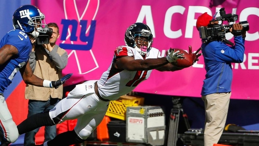 Oct 5, 2014; East Rutherford, NJ, USA; Atlanta Falcons wide receiver Julio Jones (11) dives for pass but cannot hold on during the second half against the New York Giants at MetLife Stadium. New York Giants defeat the Atlanta Falcons 30-20. Mandatory Credit: Jim O'Connor-USA TODAY Sports