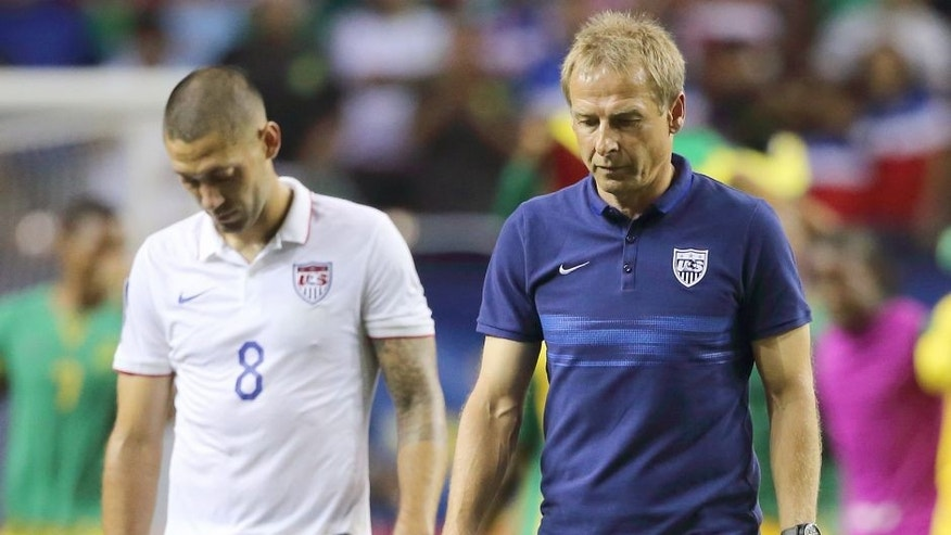 ATLANTA, GA - JULY 22: Clint Dempsey of United States of America and Jurgen Klinsmann the head coach / manager of United States of America walk off the field after the 1-2 defeat in the 2015 CONCACAF Gold Cup Semifinal between USA and Jamaica at Georgia Dome on July 22, 2015 in Atlanta, Georgia. (Photo by Matthew Ashton - AMA/Getty Images)