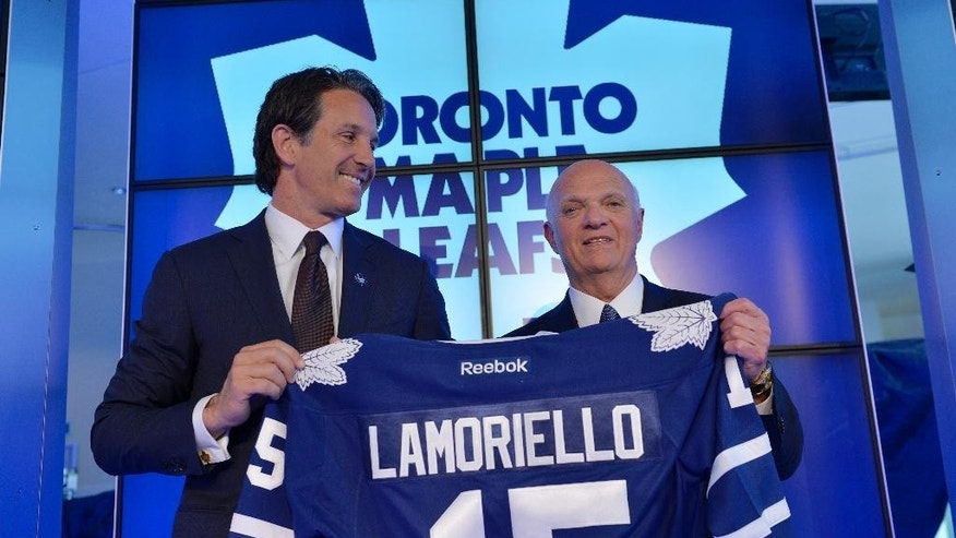 Toronto Maple Leafs President Brendan Shanahan, left,  and Lou Lamoriello hold up a jersey at a news conference to announce Lamoriello has been named the new general manager of the Maple Leafs NHL hockey team in Toronto, Thursday, July 23, 2015. (Galit Rodan/The Canadian Press via AP)