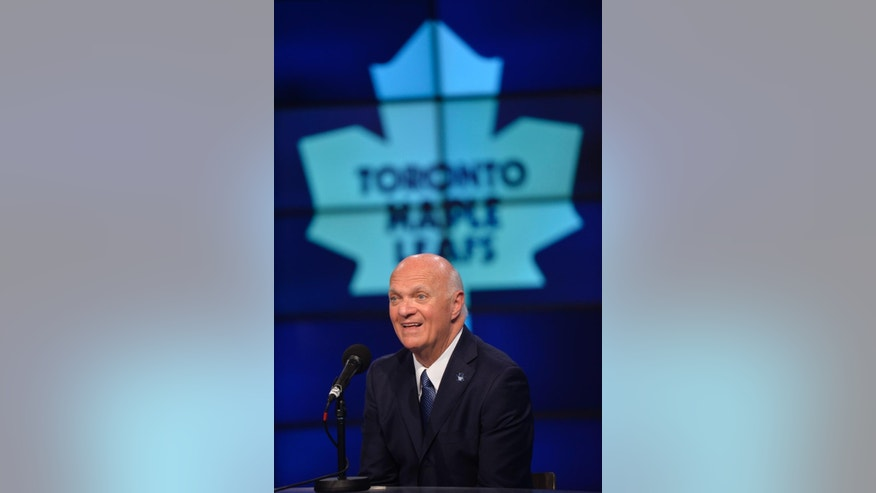 Lou Lamoriello attends a news conference to announce that he has been named the new general manager of the Toronto Maple Leafs, in Toronto, Thursday, July 23, 2015. (Galit Rodan/The Canadian Press via AP)