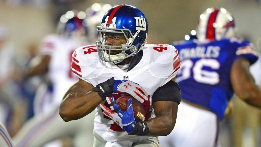 Aug 3, 2014; Canton, OH, USA; New York Giants running back Andre Williams (44) runs the ball during the second quarter of the 2014 Pro Football Hall of Fame game against the New York Giants at Fawcett Stadium. Mandatory Credit: Andrew Weber-USA TODAY Sports