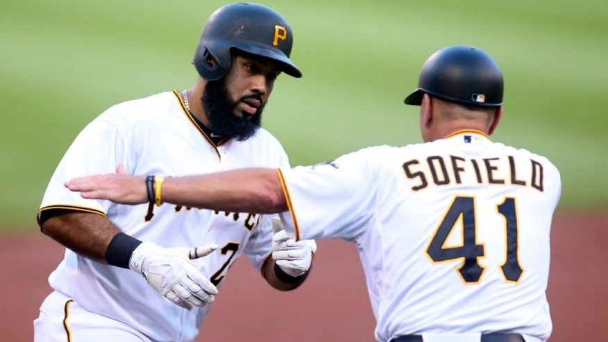 <p>Jun 10, 2015; Pittsburgh, PA, USA; Pittsburgh Pirates third base coach Rick Sofield (41) greets first baseman Pedro Alvarez (L) after Alvarez hit a solo home run against the Milwaukee Brewers during the second inning at PNC Park. Mandatory Credit: Charles LeClaire-USA TODAY Sports</p>