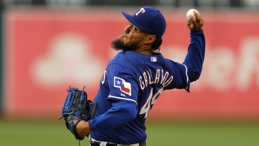 Texas Rangers pitcher Yovani Gallardo works against the Oakland Athletics during the first inning of a baseball game Wednesday, June 10, 2015, in Oakland, Calif. (AP Photo/Ben Margot)