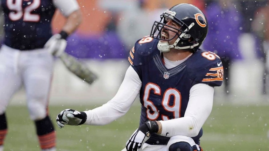 Chicago Bears defensive end Jared Allen celebrates after tackling Minnesota Vikings quarterback Teddy Bridgewater during the first half.