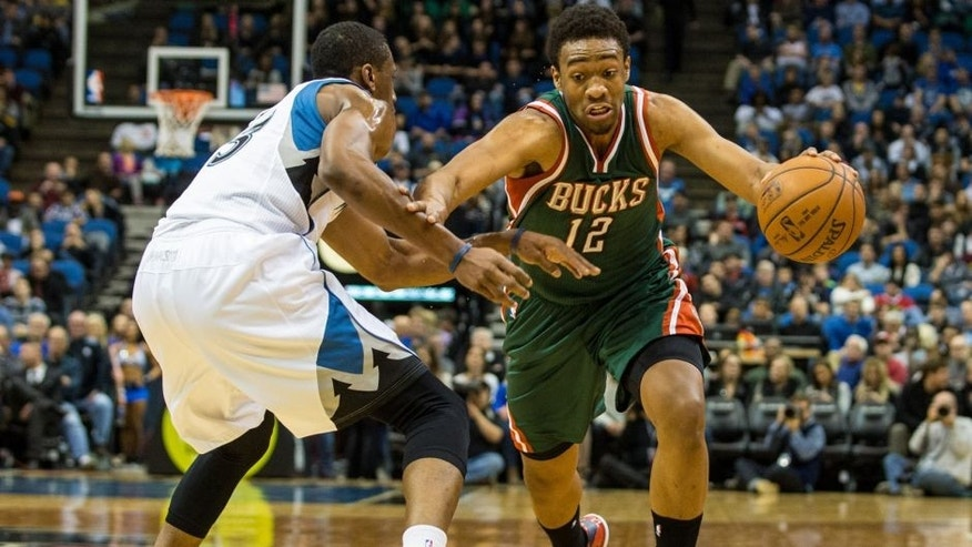 <p>Nov 26, 2014; Minneapolis, MN, USA; Milwaukee Bucks forward Jabari Parker (12) dribbles the ball around Minnesota Timberwolves forward Thaddeus Young (33) during the first quarter at Target Center. Mandatory Credit: Brace Hemmelgarn-USA TODAY Sports</p>