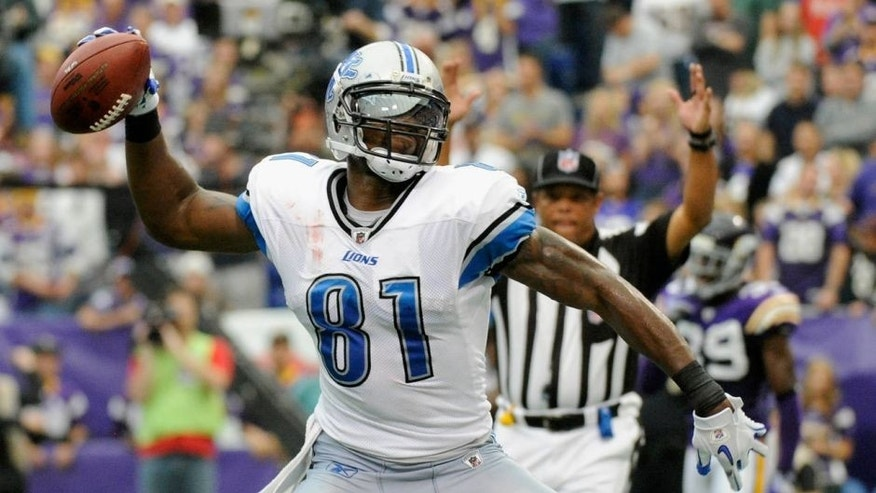 MINNEAPOLIS, MN - SEPTEMBER 25: Calvin Johnson #81 of the Detroit Lions celebrates scoring a touchdown in the fourth quarter against the Minnesota Vikings on September 25, 2011 at Hubert H. Humphrey Metrodome in Minneapolis, Minnesota. The Lions defeated the Vikings 26-23. (Photo by Hannah Foslien/Getty Images)
