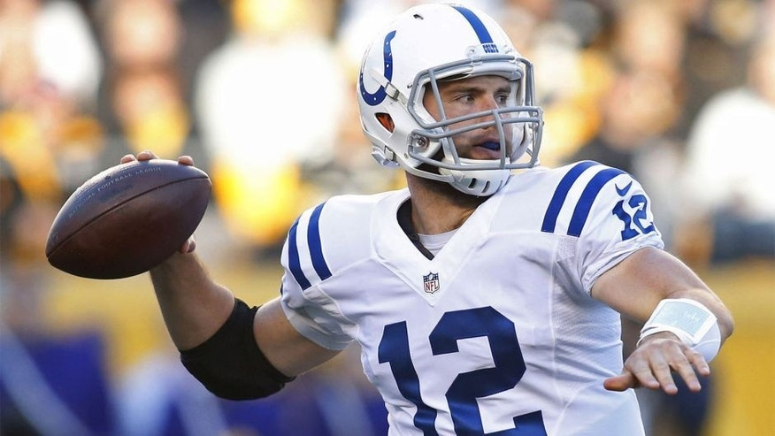 Oct 26, 2014; Pittsburgh, PA, USA; Indianapolis Colts quarterback Andrew Luck (12) passes against the Pittsburgh Steelers during the first quarter at Heinz Field. Mandatory Credit: Charles LeClaire-USA TODAY Sports