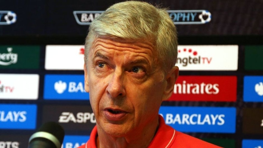 SINGAPORE - JULY 18: Arsene Wenger manager of Arsenal speaks to the media during the post match press conference after they defeated Everton 3-1 during the Barclays Asia Trophy final match between Arsenal and Everton at the National Stadium on July 18, 2015 in Singapore. (Photo by Stanley Chou/Getty Images)