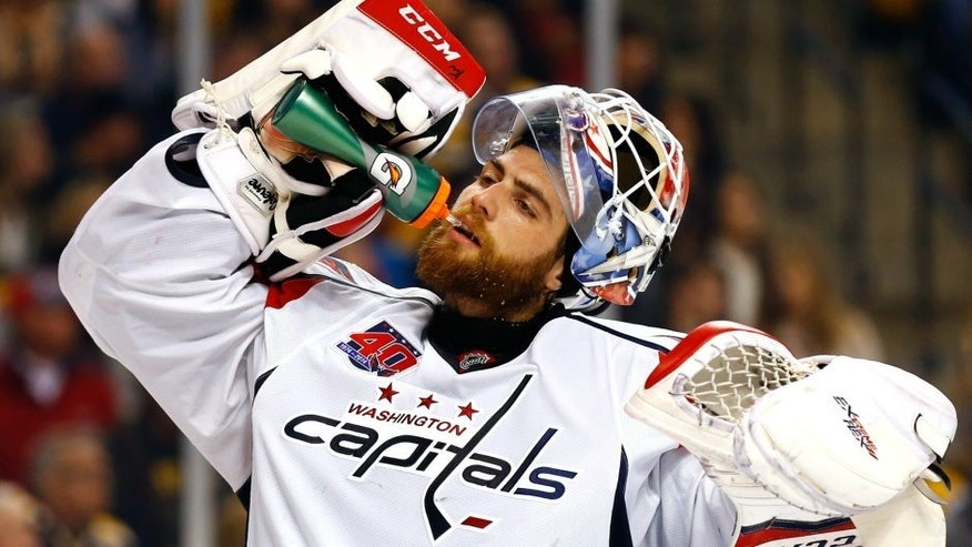 Oct 11, 2014; Boston, MA, USA; Washington Capitals goalie Braden Holtby (70) against the Boston Bruins at TD Garden. Mandatory Credit: Winslow Townson-USA TODAY Sports