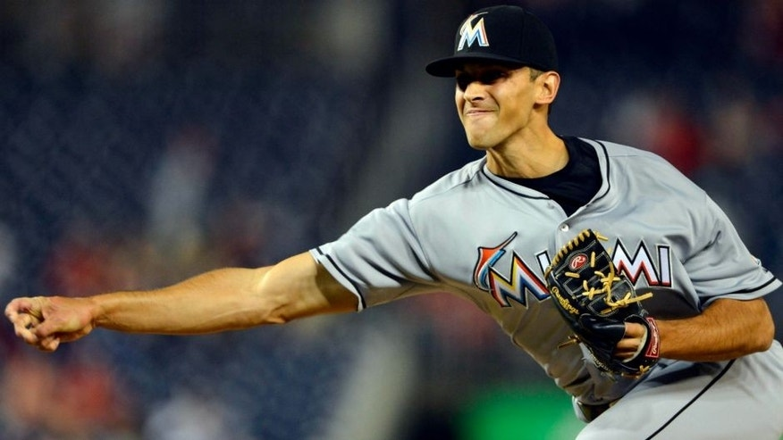 <p>May 5, 2015; Washington, DC, USA; Miami Marlins relief pitcher Steve Cishek (31) pitches during the ninth inning against the Washington Nationals at Nationals Park. Miami Marlins defeated Washington Nationals 2-1. Mandatory Credit: Tommy Gilligan-USA TODAY Sports</p>