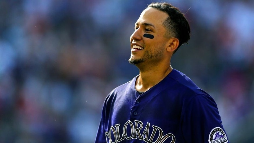 DENVER, CO - JULY 11: Carlos Gonzalez #5 of the Colorado Rockies smiles after he hit a walk-off RBI single against the Atlanta Braves in the ninth inning at Coors Field on July 11, 2015 in Denver, Colorado. The Rockies defeated the Braves 3-2. (Photo by Justin Edmonds/Getty Images)