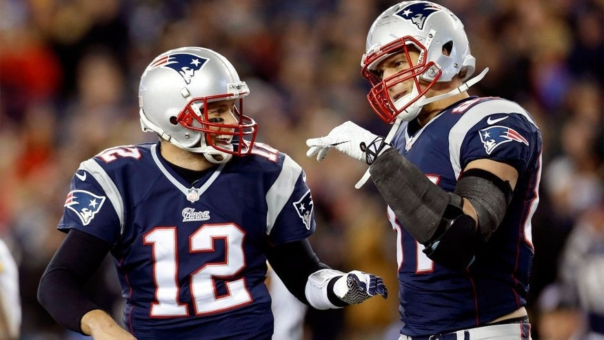 Nov 3, 2013; Foxborough, MA, USA; New England Patriots quarterback Tom Brady (12) congratulates tight end Rob Gronkowski (87) on scoring a touchdown during the second quarter against the Pittsburgh Steelers at Gillette Stadium. Mandatory Credit: Greg M. Cooper-USA TODAY Sports