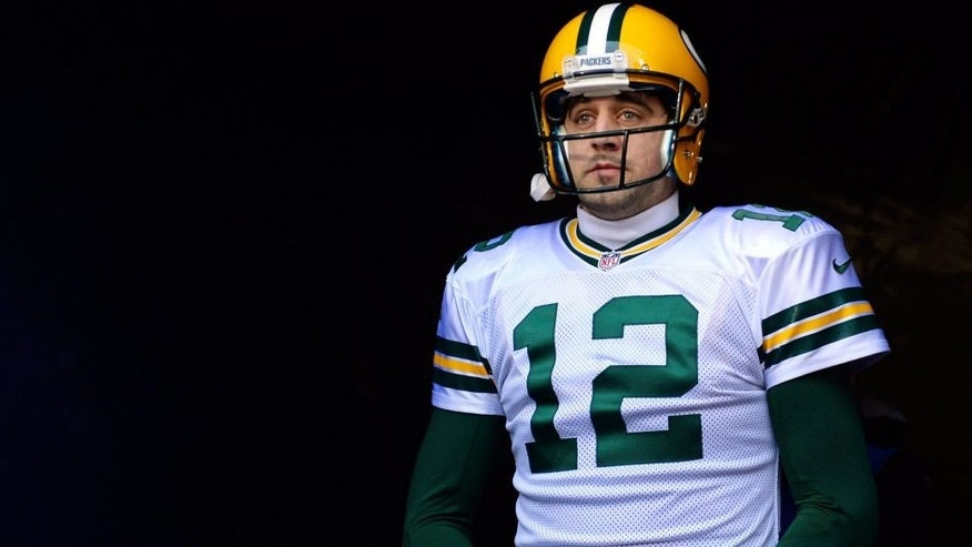 <p>Dec 29, 2013; Chicago, IL, USA; Green Bay Packers quarterback Aaron Rodgers (12) takes the field before the game against the Chicago Bears at Soldier Field.  </p>