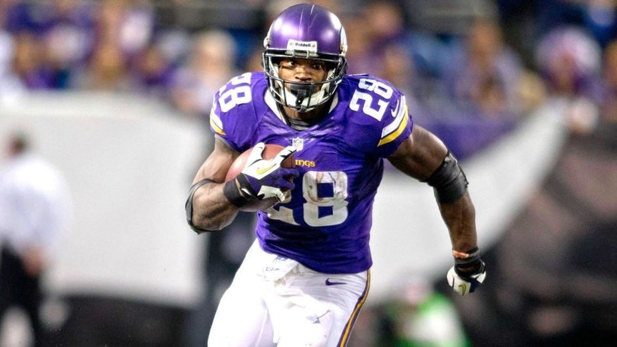 Dec 1, 2013; Minneapolis, MN, USA; Minnesota Vikings running back Adrian Peterson (28) rushes for 21 yards against the Chicago Bears in overtime at Mall of America Field at H.H.H. Metrodome. Vikings win 23-20 in overtime. Mandatory Credit: Bruce Kluckhohn-USA TODAY Sports