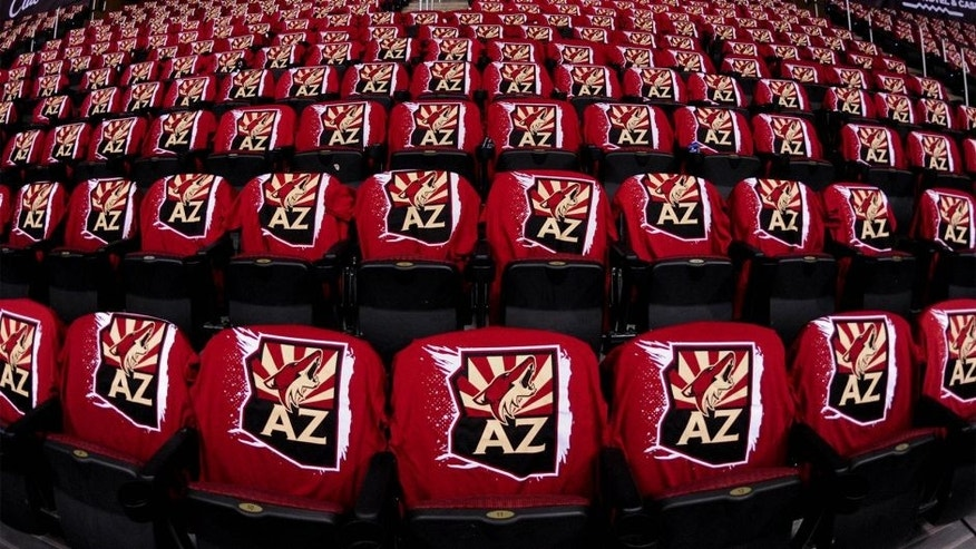 Oct 9, 2014; Glendale, AZ, USA; Tshirts on seats await fans prior to the game between the Arizona Coyotes and the Winnipeg Jets at Gila River Arena. Mandatory Credit: Matt Kartozian-USA TODAY Sports