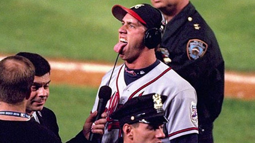 Baseball: NLCS Playoffs. Atlanta Braves John Rocker (49) taunting and gesturing fans during media interview after Game 5 vs New York Mets. Flushing, NY 10/17/1999 MANDATORY CREDIT: Al Tielemans/Sports Illustrated SetNumber: X58920
