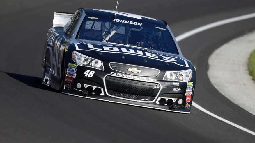 Sprint Cup Series driver Jimmie Johnson (48) drives through the first turn during practice for the NASCAR Brickyard 400 auto race at Indianapolis Motor Speedway in Indianapolis, Friday, July 24, 2015. (AP Photo/Michael Conroy)