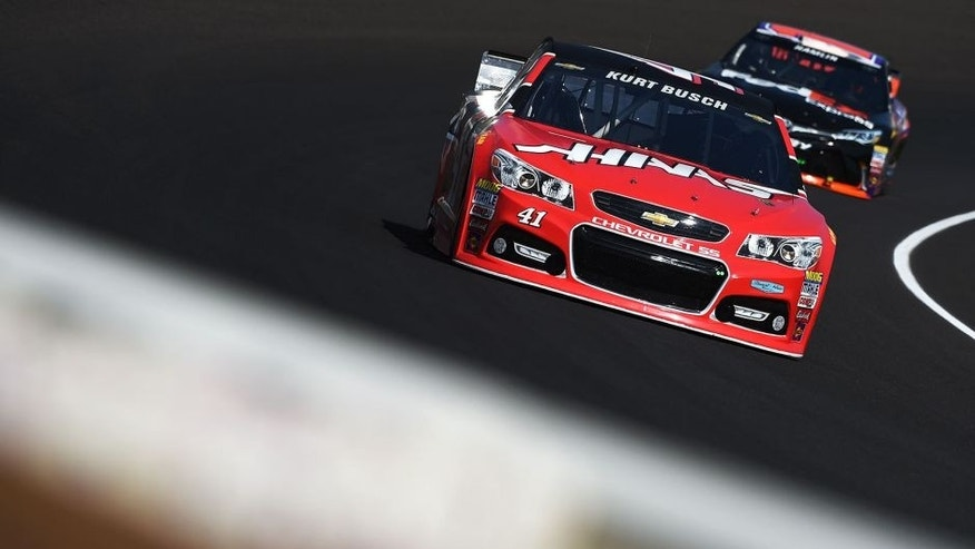 INDIANAPOLIS, IN - JULY 24: Kurt Busch, driver of the #41 Haas Automation Chevrolet, leads Denny Hamlin, driver of the #11 FedEx Express Toyota, during practice for the NASCAR Sprint Cup Series Crown Royal Presents the Jeff Kyle 400 at the Brickyard at Indianapolis Motorspeedway on July 24, 2015 in Indianapolis, Indiana. (Photo by Rainier Ehrhardt/NASCAR via Getty Images)