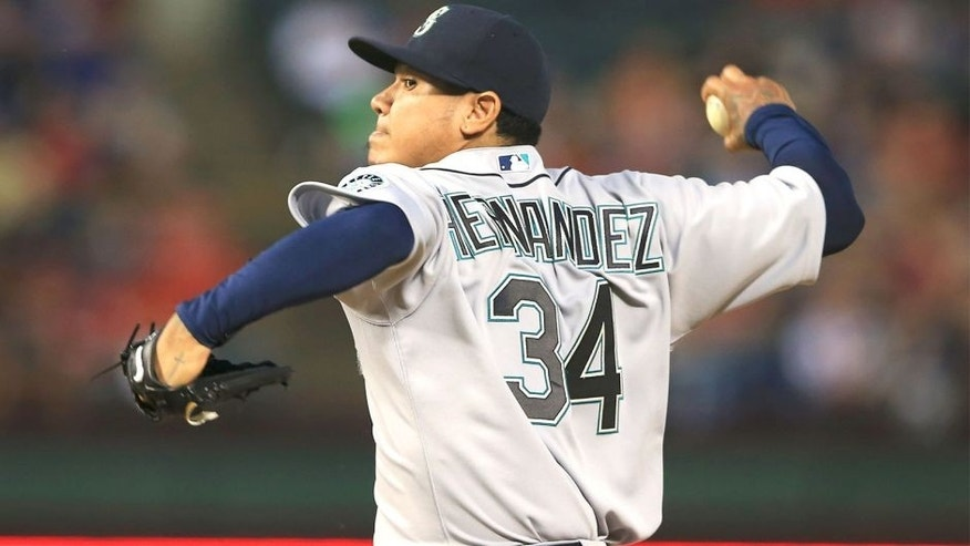 Apr 29, 2015; Arlington, TX, USA; Seattle Mariners starting pitcher Felix Hernandez (34) throws during the game against the Texas Rangers at Globe Life Park in Arlington. Mandatory Credit: Kevin Jairaj-USA TODAY Sports