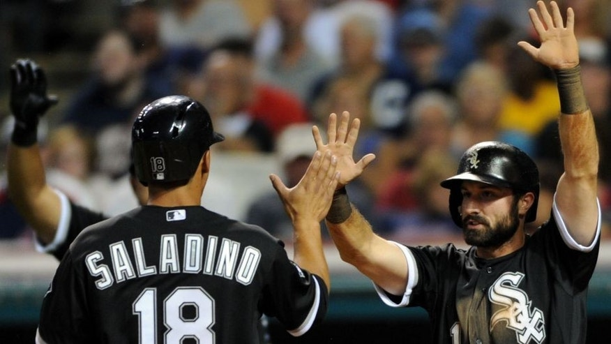 Jul 24, 2015; Cleveland, OH, USA; Chicago White Sox third baseman Tyler Saladino (18) and Chicago White Sox center fielder Adam Eaton (1) celebrate after scoring during the eighth inning against the Cleveland Indians at Progressive Field. Mandatory Credit