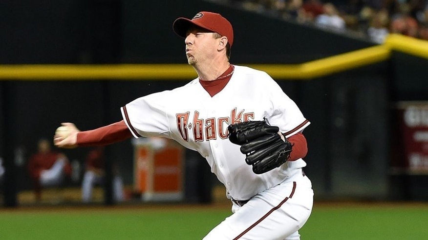 PHOENIX, AZ - APRIL 24: Brad Ziegler #29 of the Arizona Diamondbacks delivers a pitch against the Pittsburgh Pirates at Chase Field on April 24, 2015 in Phoenix, Arizona. (Photo by Norm Hall/Getty Images)