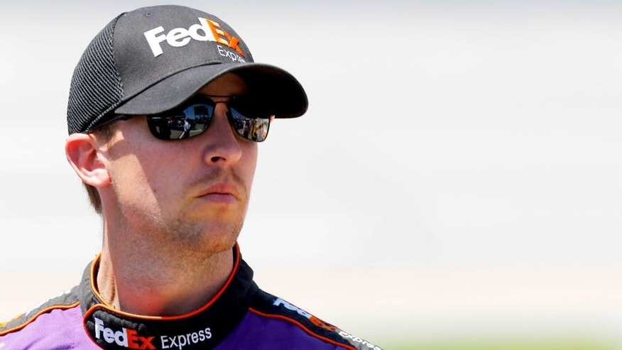 TALLADEGA, AL - MAY 02: Denny Hamlin, driver of the #11 FedEx Express Toyota, stands on the grid during qualifying for the NASCAR Sprint Cup Series GEICO 500 at Talladega Superspeedway on May 2, 2015 in Talladega, Alabama. (Photo by Jerry Markland/Getty Images)