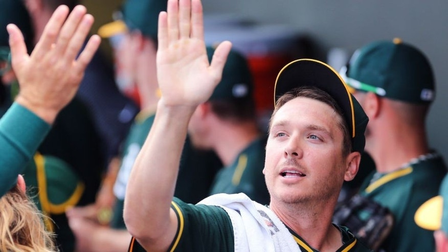 Mar 12, 2015; Mesa, AZ, USA; Oakland Athletics pitcher Scott Kazmir (26) walks into the dugout prior to the start of a spring training game against the Seattle Mariners at HoHoKam Stadium. The A's beat the Mariners 4-3. Mandatory Credit: Allan Henry-USA TODAY Sports