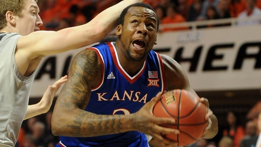 Feb 7, 2015; Stillwater, OK, USA; Kansas Jayhawks forward Cliff Alexander (2) attempts a shot against Oklahoma State Cowboys forward/center Mitchell Solomon (41) during the first half at Gallagher-Iba Arena. Mandatory Credit: Mark D. Smith-USA TODAY Sports