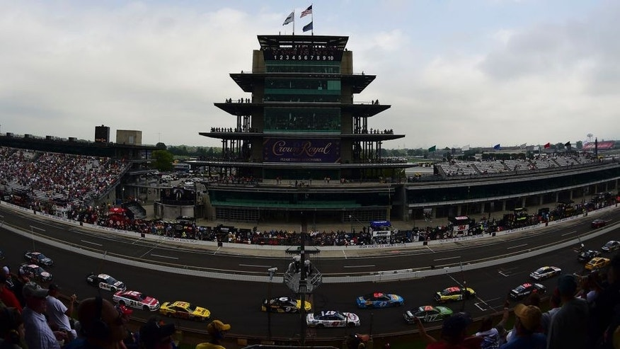 Drivers race by the Pagoda during the NASCAR Sprint Cup Series Crown Royal Presents The John Wayne Walding 400 at the Brickyard Indianapolis Motor Speedway on July 27, 2014 in Indianapolis, Indiana.