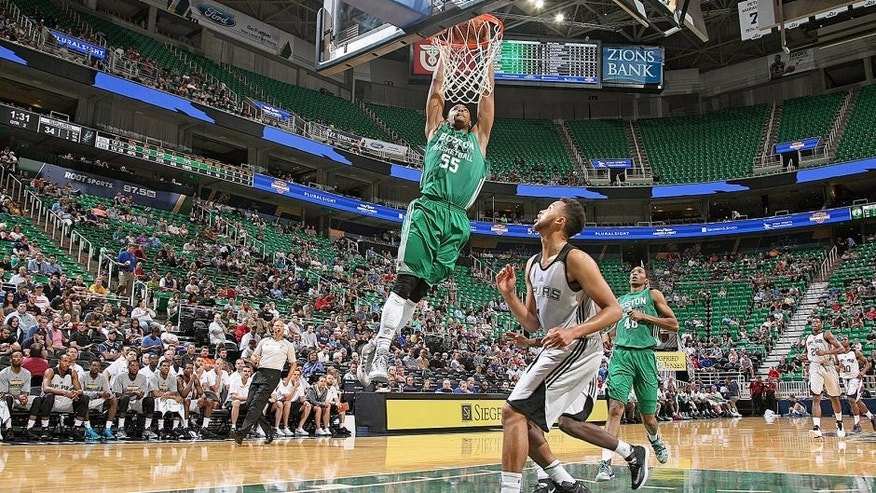 SALT LAKE CITY, UT - JULY 9: Jordan Mickey #55 of the Boston Celtics dunks against the San Antonio Spurs during the Utah Jazz Summer League on July 9, 2015 at EnergySolutions Arena in Salt Lake City, Utah. NOTE TO USER: User expressly acknowledges and agrees that, by downloading and or using this Photograph, user is consenting to the terms and conditions of the Getty Images License Agreement. Mandatory Copyright Notice: Copyright 2015 NBAE (Photo by Melissa Majchrzak/NBAE via Getty Images)