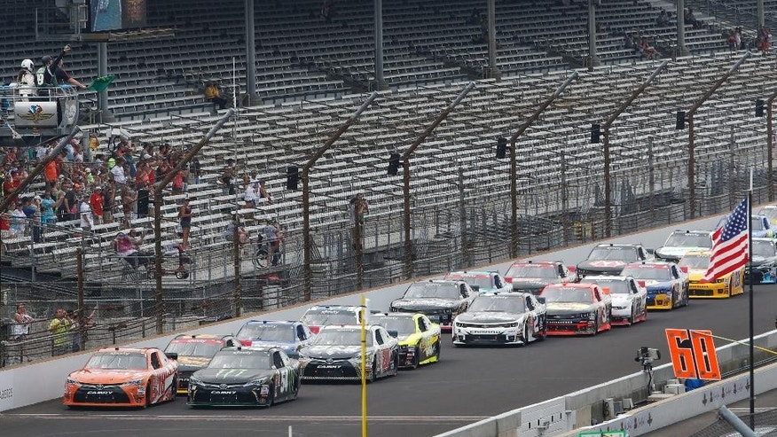 Cars come to the start/finish line as the green flag drops to start the NASCAR Xfinity Series auto race at Indianapolis Motor Speedway in Indianapolis, Saturday, July 25, 2015. (AP Photo/AJ Mast)