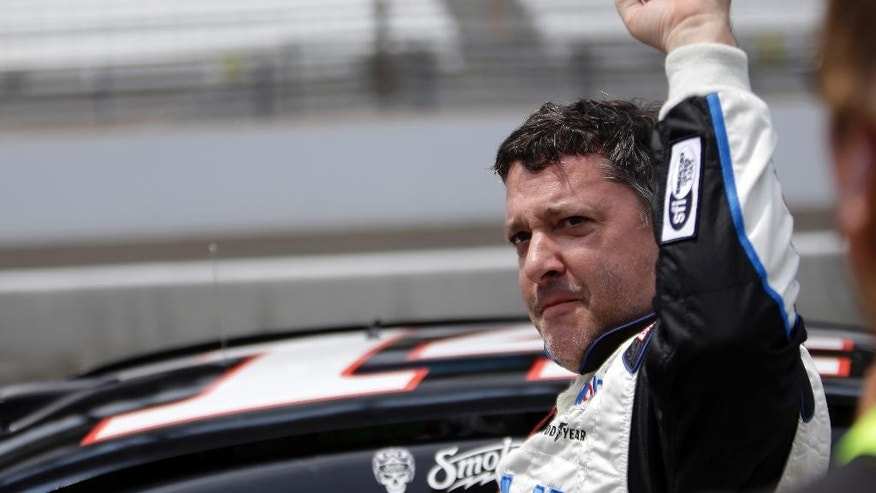 Sprint Cup Series driver Tony Stewart (14) gesture to the fans after he qualified for the NASCAR Brickyard 400 auto race at Indianapolis Motor Speedway in Indianapolis, Saturday, July 25, 2015. (AP Photo/AJ Mast)