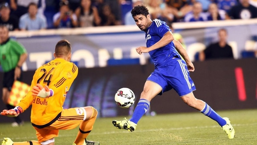 Chelsea's forward Diego Costa (R) kicks the ball past the New York Red Bulls goalkeeper Santiago Castano during their International Champions Cup match at the Red Bull Arena in Harrison, New Jersey, on July 22, 2015. New York Red Bulls defeated Chelsea 4-2. AFP PHOTO/JEWEL SAMAD (Photo credit should read JEWEL SAMAD/AFP/Getty Images)