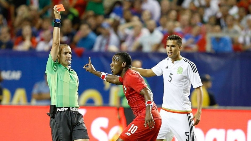 ATLANTA, GA - JULY 22: Referee Mark Geiger gives a red card to Luis Tejada #10 of Panama while Francisco Rodriguez #2 of Mexico lays on the field and Diego Reyes #5 of Mexico reacts during the 2015 CONCACAF Gold Cup semifinal match at Georgia Dome on July 22, 2015 in Atlanta, Georgia. (Photo by Mike Zarrilli/Getty Images)