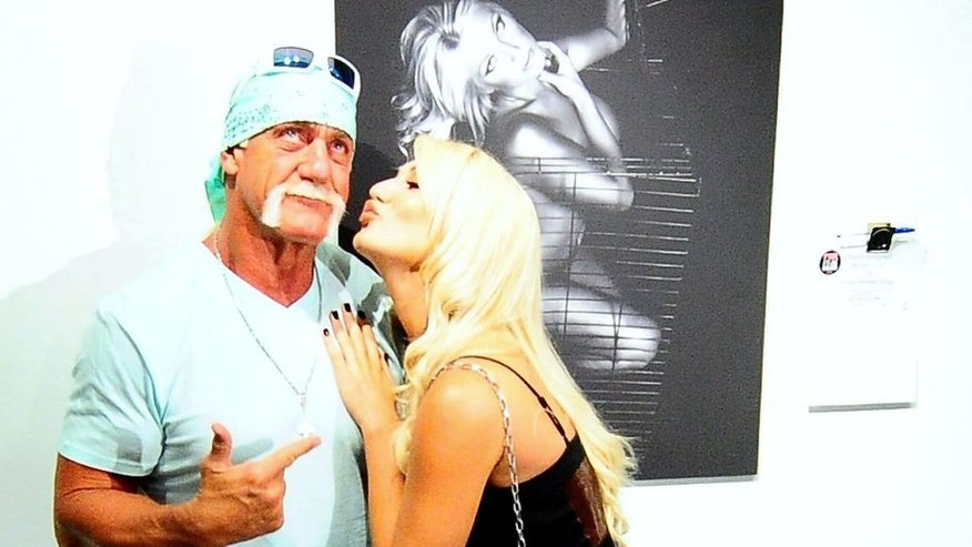 MIAMI, FL - AUGUST 11: Hulk Hogan and Brooke Hogan attend Brooke Hogan's portrait unveiling at Women In cages exhibit at Cafeina Lounge on August 11, 2011 in Miami, Florida. (Photo by Gustavo Caballero/Getty Images)