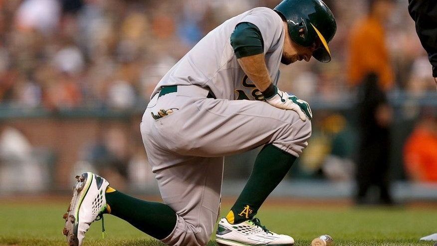 <p>SAN FRANCISCO, CA - JULY 24: Billy Burns #1 of the Oakland Athletics is slow to his feet after being hit by the ball while at bat in the third inning against the San Francisco Giants at AT&T Park on July 24, 2015 in San Francisco, California. (Photo by Lachlan Cunningham/Getty Images)</p>