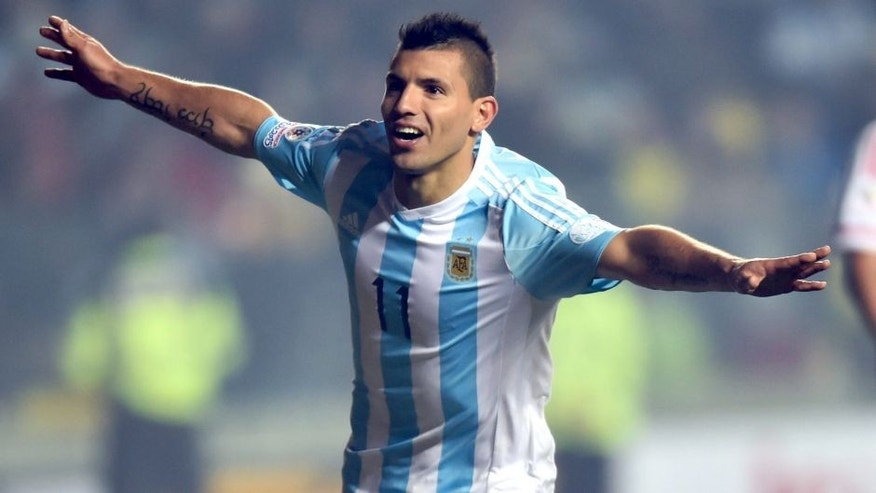 Argentina's forward Sergio Aguero (L) celebrates after scoring against Paraguay during their Copa America semifinal football match in Concepcion, Chile on June 30, 2015. AFP PHOTO / YURI CORTEZ (Photo credit should read YURI CORTEZ/AFP/Getty Images)