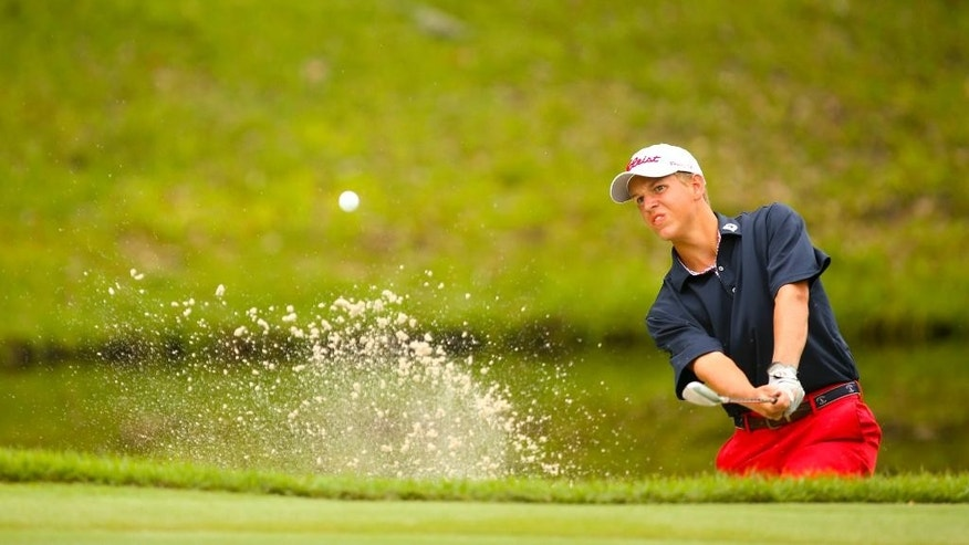 In a photo provided by the USGA, Andrew Orischak blasts out of a bunker on the 17th hole during match play of the U.S. Junior Amateur golf tournament at Colleton River Plantation Club in Bluffton, S.C., on Friday, July 24, 2015. (Darren Carroll/USGA via AP)