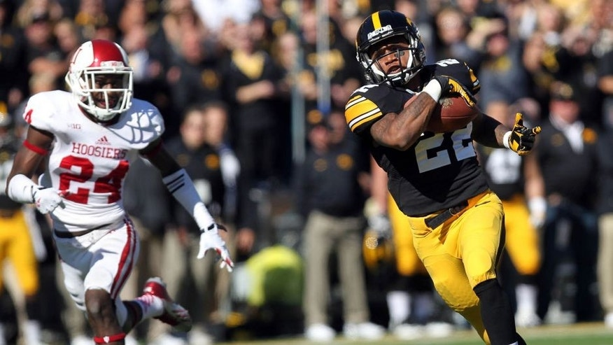 Oct 11, 2014; Iowa City, IA, USA; Iowa Hawkeyes wide receiver Damond Powell (22) catches a pass for a touch down against the Indiana Hoosiers at Kinnick Stadium. Mandatory Credit: Reese Strickland-USA TODAY Sports