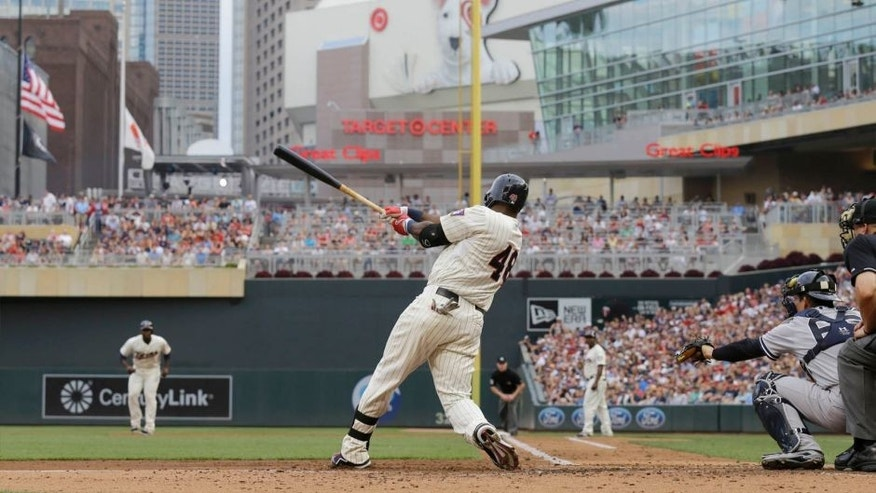The Minnesota Twins' Torii Hunter hits a three-run home run off New York Yankees starting pitcher CC Sabathia during the third inning in Minneapolis, Saturday, July 25, 2015.