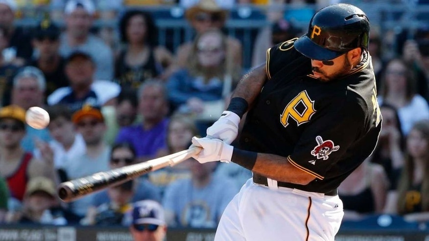 Saturday, June 7: The Pittsburgh Pirates' Pedro Alvarez drives in a run with a broken-bat single off Milwaukee Brewers starting pitcher Matt Garza during the third inning.