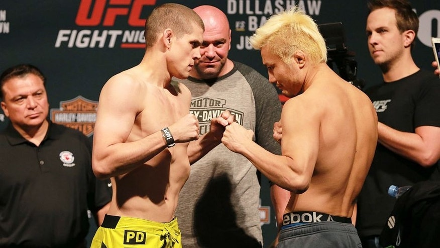 CHICAGO, IL - JULY 24: (L-R) Opponents Joe Lauzon and Takanori Gomi of Japan face off during the UFC weigh-in at the United Center on July 24, 2015 in Chicago, Illinois. (Photo by Rey Del Rio/Zuffa LLC/Zuffa LLC via Getty Images)