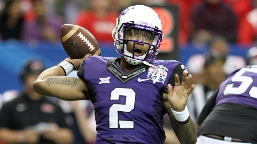 Dec 31, 2014; Atlanta , GA, USA; TCU Horned Frogs quarterback Trevone Boykin (2) throws the ball against the Mississippi Rebels during the first quarter in the 2014 Peach Bowl at the Georgia Dome. Mandatory Credit: Jason Getz-USA TODAY Sports