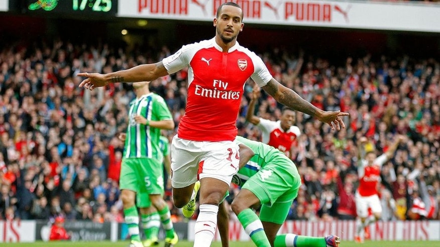LONDON, ENGLAND - JULY 26: Theo Walcott of Arsenal celebrates scoring a goal during the Emirates cup match between Arsenal and Vfl Wolfsburg at The Emirates Stadium on July 26, 2015 in London, United Kingdom. (Photo by Mitchell Gunn/Getty Images)