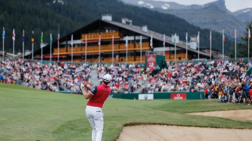 Winner Danny Willett of England plays the ball on the green of the 18th hole during the final round of the Omega European Masters golf tournament in Crans-Montana, Switzerland, Sunday, July 26, 2015. (Peter Klaunzer/Keystone via AP)