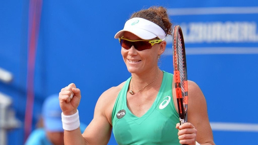 Australia's winner Samantha Stosur celebrates after her final match against  Karin Knapp from Italy at the  WTA tennis tournament in Bad Gastein, Austria, on Sunday, July 26, 2015. Stosur won with 3-6, 7-6 and 6-2. (AP Photo/Kerstin Joensson)