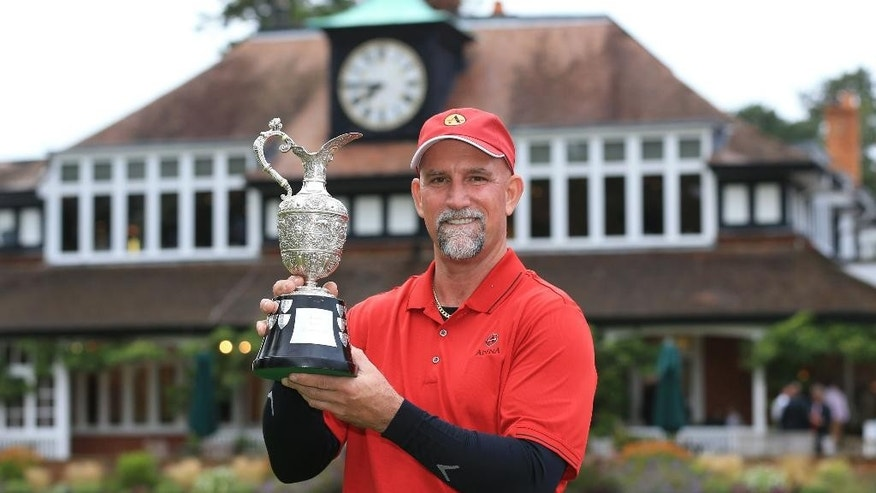 USA's Marco Dawson Senior celebrates winning the 2015 Senior Open Golf Championship at Sunningdale Golf Club,  England, Sunday, July 26, 2015.  (Nigel French/PA via AP)     UNITED KINGDOM OUT  S